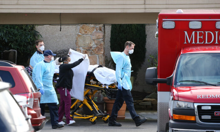 A patient is transferred into an ambulance at the Life Care Center in Kirkland, Washington, on March 7, 2020. (Karen Ducey/Getty Images)