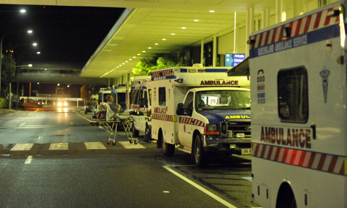 Ambulances are lined up outside the International Terminal at Cairns Airport in Queensland, Australia, on Feb. 2, 2011. (Paul Crock/AFP via Getty Images)