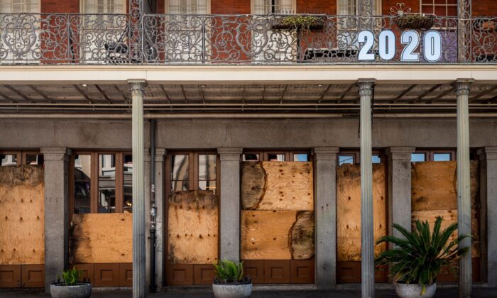 A shuttered business is pictured on Decatur Street in New Orleans on March 26, 2020. (Emily Kask/AFP/Getty Images)
