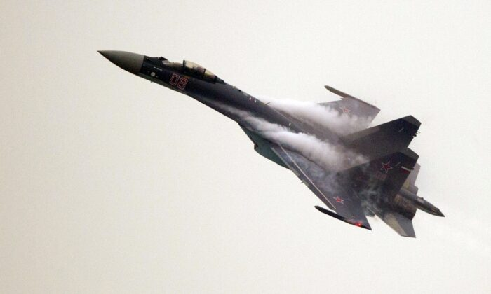 A Sukhoi SU-35 fighter jet performs during a test flight ahead of the Airshow China 2014 in Zhuhai, Guangdong Province, China, on Nov. 10, 2014.  (Johannes Eisele/AFP via Getty Images)