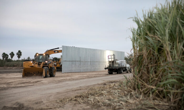 A loader grades land near a section of privately built border wall under construction near Mission, Texas, on Dec. 11, 2019. (John Moore/Getty Images)