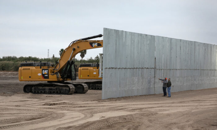 A loader grades land near a section of privately-built border wall under construction near Mission, Texas on Dec. 11, 2019. (John Moore/Getty Images)
