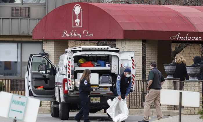 Paramedics and healthcare officials are seen outside Andover Subacute and Rehab Center, during the CCP virus outbreak, in Andover, N.J., on April 16, 2020. (Stefan Jeremiah/Reuters)