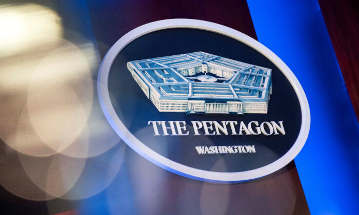 The Pentagon logo is seen behind the podium in the briefing room at the Pentagon in Arlington, Virginia, on Jan. 8, 2020. (Al Drago/Reuters)