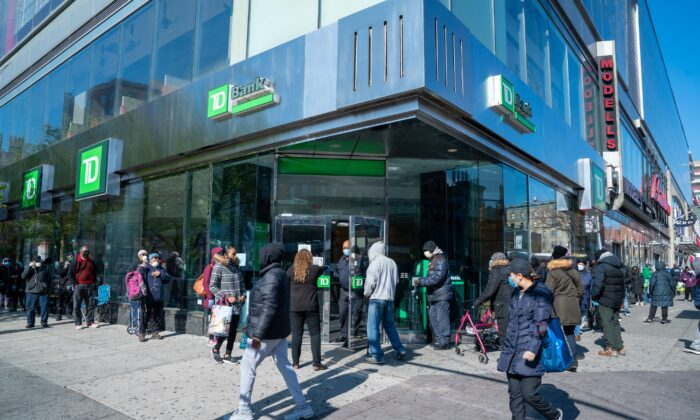People wait in line outside TD Bank in Harlem, New York City, on April 16, 2020. (David Dee Delgado/Getty Images)