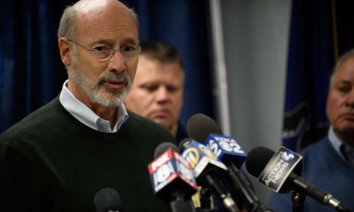 Pennsylvania Gov. Tom Wolf speaks to reporters in Pittsburgh in a file photograph. (Jeff Swensen/Getty Images)