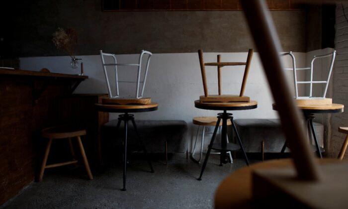 Stools are turned upside down in a cafe that is closed for regular business but open for takeout in the Wudaoying Hutong, one of the top tourist destinations in Beijing, as the spread of the CCP virus continues in China, on April 10, 2020. (Thomas Peter/Reuters)
