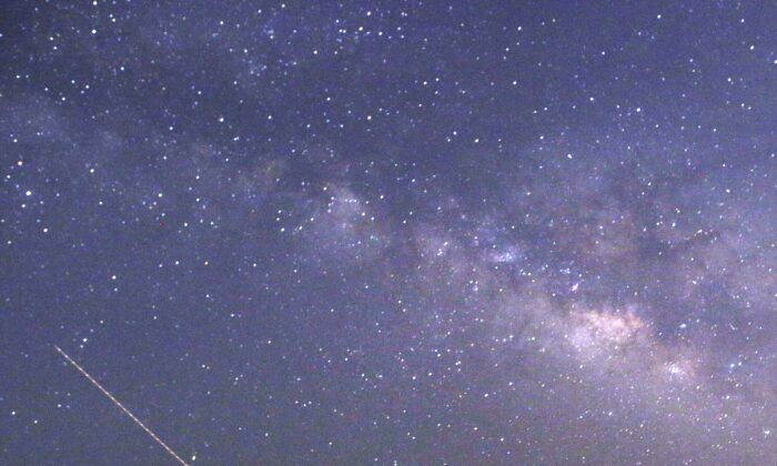 A meteor shower from Halley's Comet will streak through the night sky. (Ye Aung Thu/AFP via Getty Images)