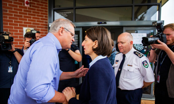SYDNEY, AUSTRALIA - DECEMBER 22, 2019: Prime Minister Scott Morrison greets Premier of New South Wales, Gladys Berejiklian  (Photo by Jenny Evans/Getty Images)