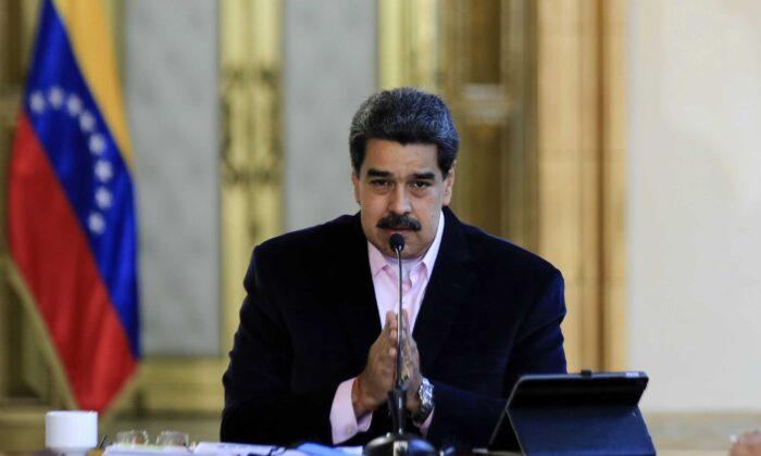 Venezuelan President Nicolas Maduro speaks during a televised announcement at Miraflores Presidential Palace in Caracas on March 26, 2020. (Jhonn Zerpa/Venezuelan Presidency/AFP via Getty Images)