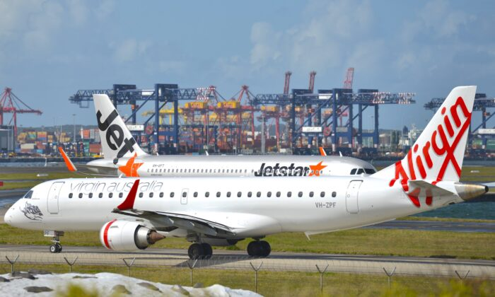 Virgin and Jetstar planes get ready to take off from Sydney Airport on Aug. 28, 2014. (Peter Parks/AFP via Getty Images)