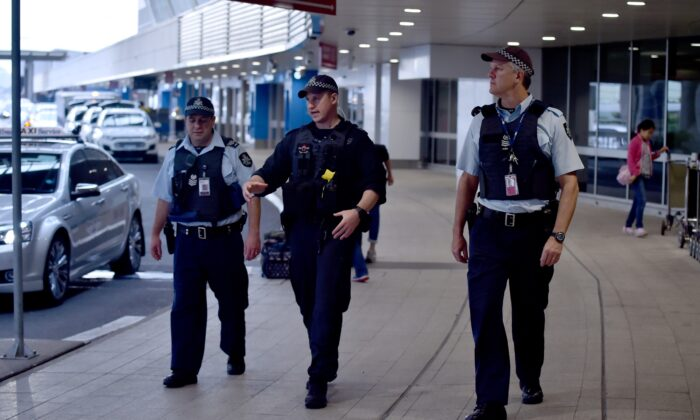 Police walk outside the international terminal as they patrol Sydney Airport on July 31, 2017. (PETER PARKS/AFP via Getty Images)