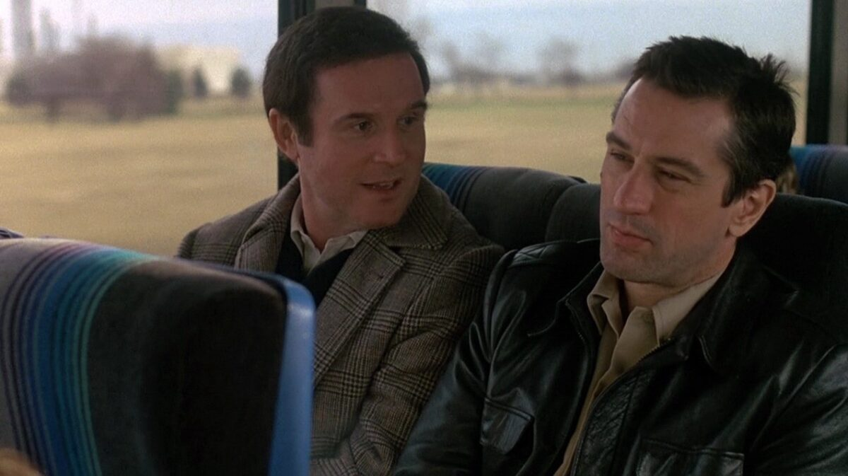 """two men on a bus in """"Midnight Run."""""""