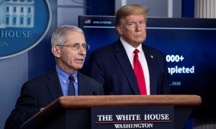 Dr. Anthony Fauci, director of the National Institute of Allergy and Infectious Diseases, about the CCP virus, as President Donald Trump listens, in the James Brady Press Briefing Room of the White House, in Washington, on April 17, 2020. (Alex Brandon/AP Photo)