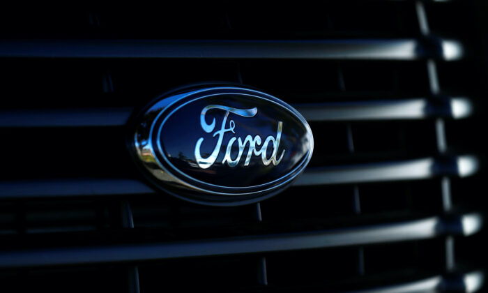 The front grill logo of a Ford pickup truck is seen in this photo taken in Carlsbad, California on Nov. 5, 2014. (Mike Blake/Reuters)
