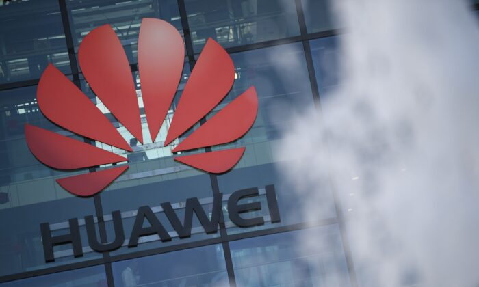 A photograph shows the logo of Chinese company Huawei at their main UK offices in Reading, west of London, on January 28, 2020. (Daniel Leal-Olivas/AFP via Getty Images)