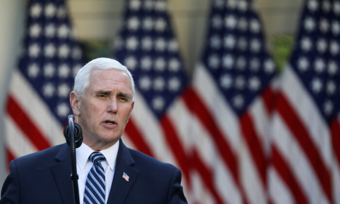 Vice President Mike Pence addresses the daily CCP virus task force briefing in the Rose Garden at the White House on April 15, 2020. (Leah Millis/Reuters)