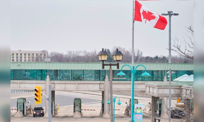 A car stops at a Canadian customs booth in Niagara Falls, Canada, on March 18, 2020. (Geoff Robins/AFP via Getty Images)