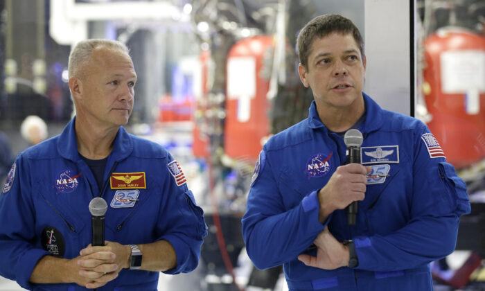 NASA astronauts Bob Behnken, right, with Doug Hurley talk to the media in front of the Crew Dragon spacecraft, about the progress to fly astronauts to and from the International Space Station, from American soil, as part of the agency's commercial crew program at SpaceX headquarters, in Hawthorne, Calif., on Oct. 10, 2019. (Alex Gallardo/AP Photo)