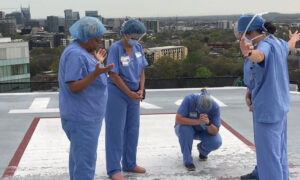 Nurses Gather at Hospital Helipad to Pray for Patients and Families Amid COVID-19 Outbreak