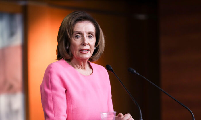 House Speaker Nancy Pelosi (D-Calif.) holds a press conference at the U.S. Capitol in Washington on March 26, 2020. (Charlotte Cuthbertson/The Epoch Times)