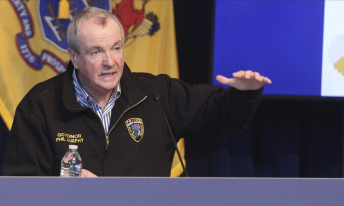 New Jersey Gov. Phil Murphy holds a news conference regarding COVID-19 cases, at the War Memorial in Trenton, N.J., on April 11, 2020. (Chris Pedota/The Record via AP, Pool)