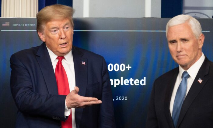 President Donald Trump gestures to Vice President Mike Pence during the daily briefing on the CCP virus in the Brady Briefing Room of the White House in Washington on April 17, 2020. (Jim Watson/AFP via Getty Images)
