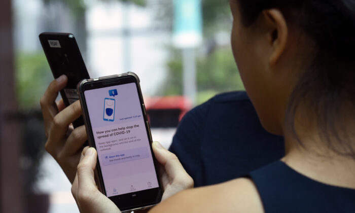 'COVID Trace' will be similar to Singapore's contact-tracing app called TraceTogether. (Catherine LAI/AFP via Getty Images)