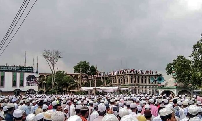 Muslim devotees attend a funeral prayer for an Islamic preacher during a government-imposed nationwide lockdown as a preventive measure against COVID-19, in Brahmanbaria also known as Sarail, Bangladesh, on April 18, 2020. (STR/AFP via Getty Images)
