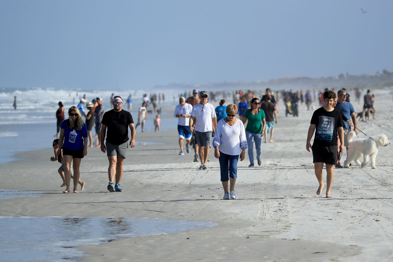 People are seen at the beach in Jacksonville Beach