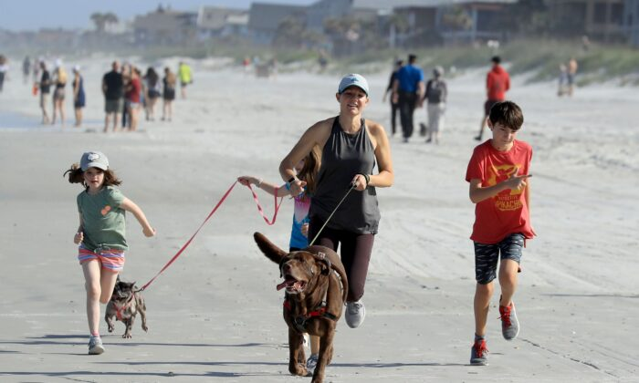 People run on the beach in Jacksonville Beach, Fla., on April 17, 2020. (Sam Greenwood/Getty Images)