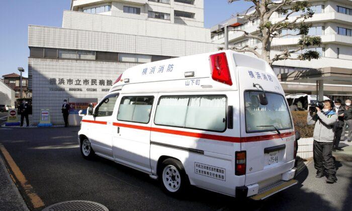 An ambulance carrying a passenger onboard cruise ship Diamond Princess arrives at a hospital in Yokohama, near Tokyo on Feb. 5, 2020. (Sadayuki Goto/Kyodo News via AP)