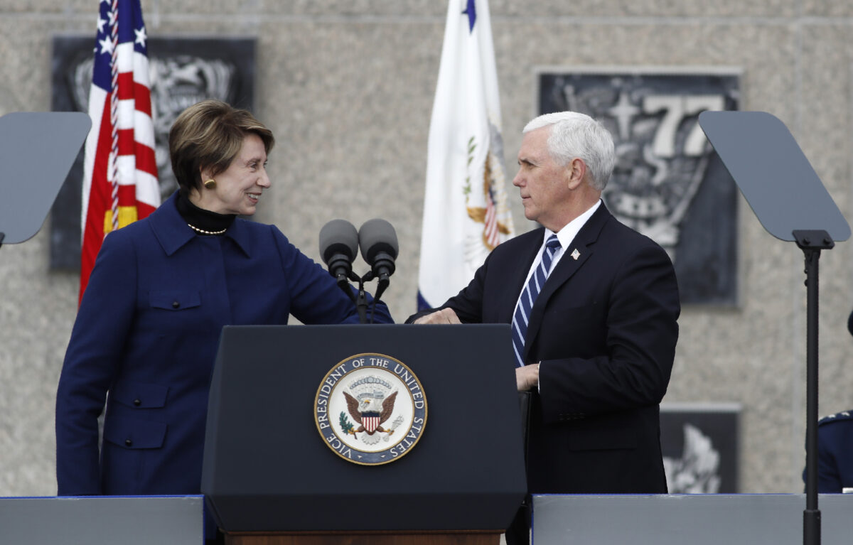 Secretary of the Air Force Barbara Barrett (L) bumps elbows to greet Vice President Mike Pence