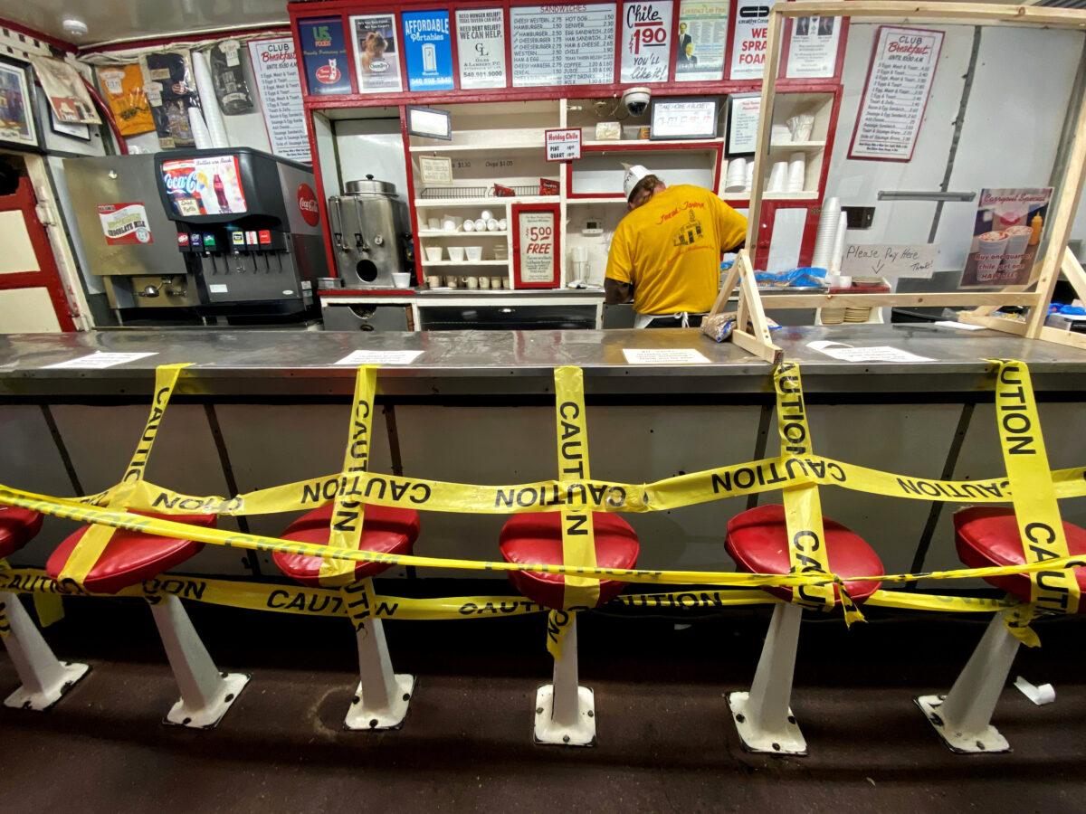 An employee prepares a take away order