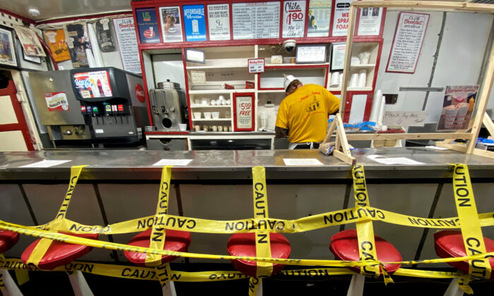 An employee prepares a take away order at a fast food restaurant as the spread of the CCP virus affected local business in Roanoke, Va., on April 18, 2020. (Carlos Barria/Reuters)
