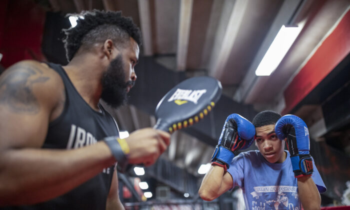 """Mike Steadman (R) trains with one of his fighters Wilkins """"Nano"""" Calendario. (Courtesy of Ironbound Boxing)"""