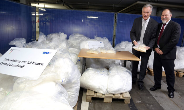 Joerg Ziercke, president BKA and Peter Ko, NPC, present portions of crystal met and 2.9 tonnes of  confiscated chlorephedrin, one of the main ingredients used to manufacture methamphetamine.