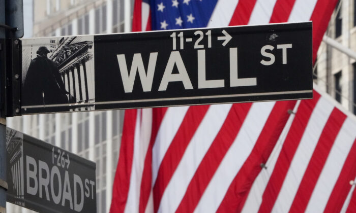 A street sign for Wall Street outside the New York Stock Exchange on March 9, 2020. (Carlo Allegri/Reuters)