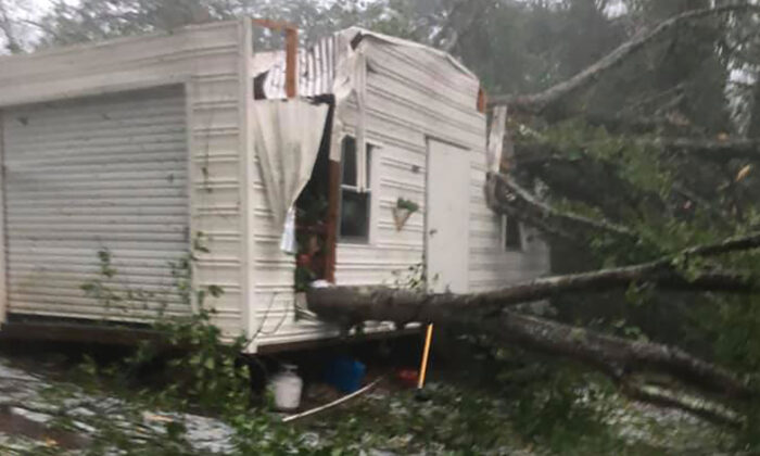 Johnette Lamborne's home, car ,and storage damaged by the storm in Alexander City, Al., on April 19, 2020. (Courtesy of Johnette Lamborne)