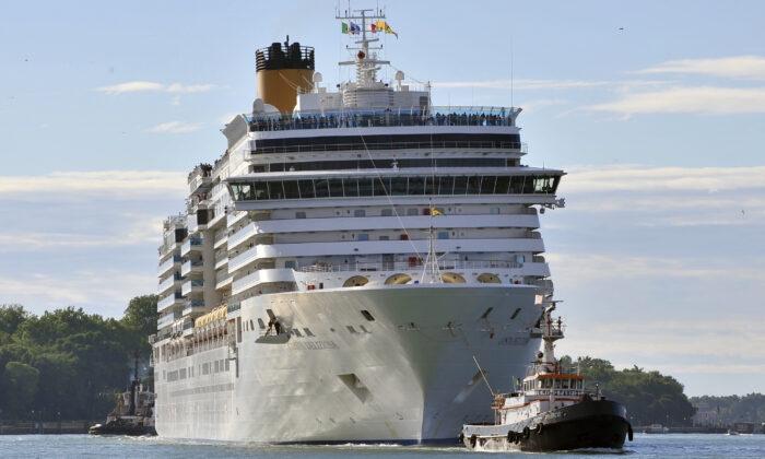 The Costa Deliziosa cruise ship leaves Venice, Italy on May 24, 2015. (AP Photo/Luigi Costantini)