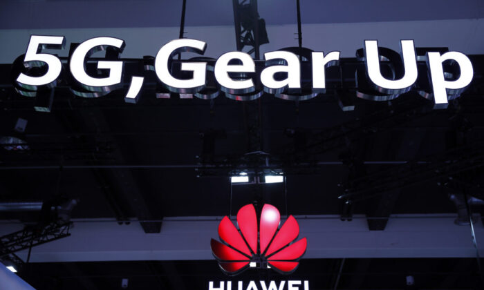 Huawei and 5G signs on display during the 10th Global Mobile Broadband Forum hosted by Chinese tech giant Huawei in Zurich, Switzerland, on Oct. 15, 2019. (Stefan Wermuth/AFP via Getty Images)