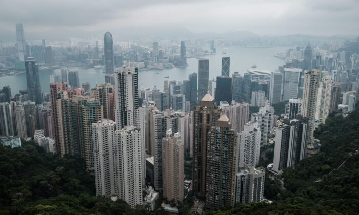 A general view, taken from the tourist attraction Victoria Peak, shows the skylines of Kowloon (back) and Hong Kong Island (foreground) in Hong Kong on April 7, 2020. (ANTHONY WALLACE/AFP via Getty Images)