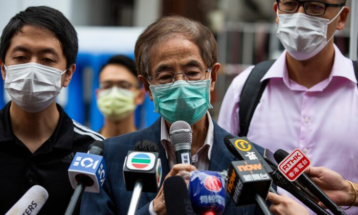 Former lawmaker and pro-democracy activist Martin Lee (C) talks to members of the media as he leaves the Central District police station in Hong Kong on April 18, 2020, after being arrested and accused of organizing and taking part in an unlawful assembly in August last year. (Isaac Lawrence/AFP via Getty Images)