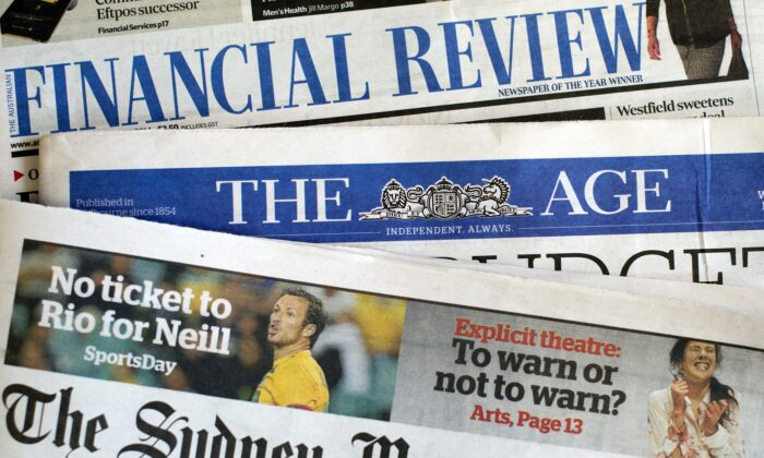 Newspaper front pages of media group Fairfax in Sydney on May 7, 2014. (SAEED KHAN/AFP via Getty Images)