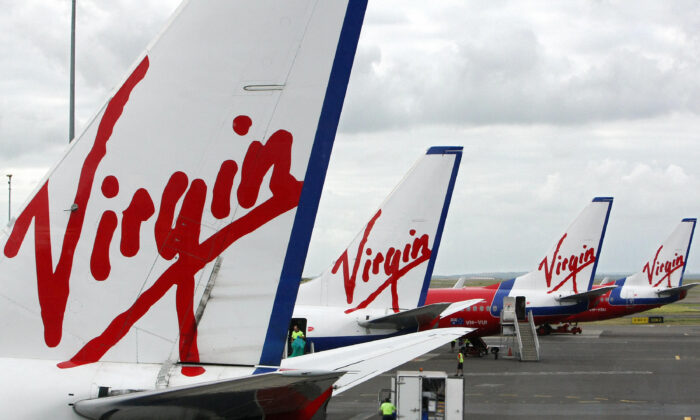 Virgin Blue line the apron at Sydney Airport on January 9, 2008. (Torsten Blackwood/Getty Images)