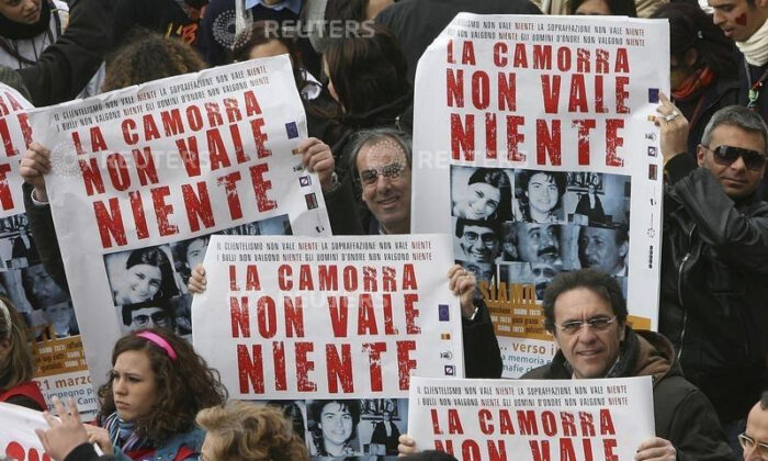 """Demonstrators hold banners reading """"Camorra worth nothing"""" as they march in the southern city of Naples March 21, 2009. (Ciro De Luca/Reuters File)"""