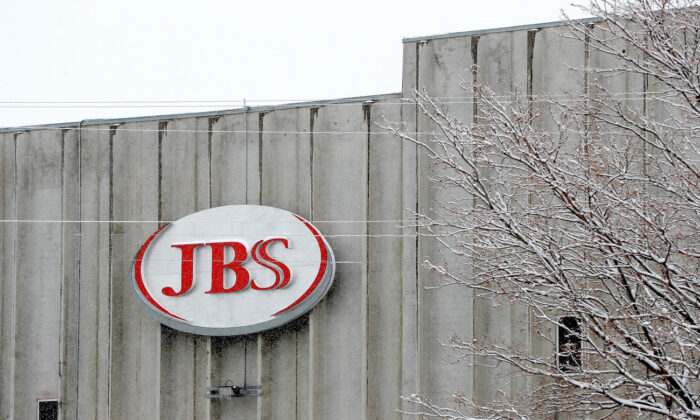 File photo of the logo of JBS as seen at the Greeley JBS meat packing plant Greeley, Colorado on April 16, 2020. The meat packing facility has voluntarily closed until April 24 in order to test employees for the CCP virus. (Matthew Stockman/Getty Images)