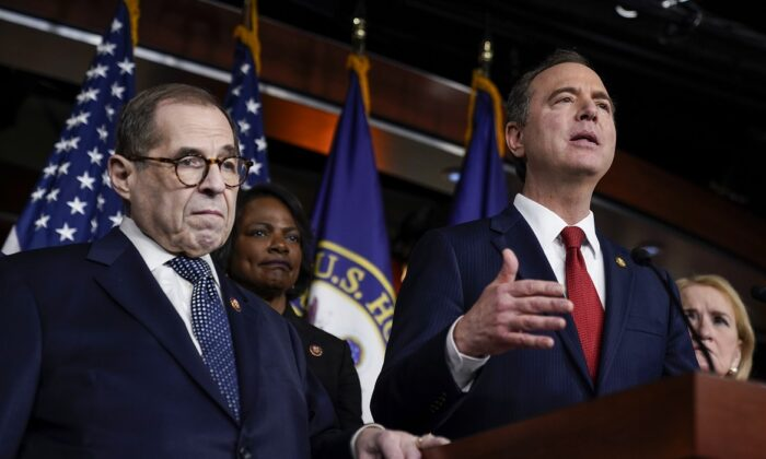 House impeachment managers Rep. Jerry Nadler (D-N.Y.) and Rep. Val Demmings (D-Fla.) look on as Rep. Adam Schiff (D-Calif.) speaks during a press conference after the Senate adjourned for the day during the Senate impeachment trial at the Capitol in Washington on Jan. 28, 2020. (Drew Angerer/Getty Images)