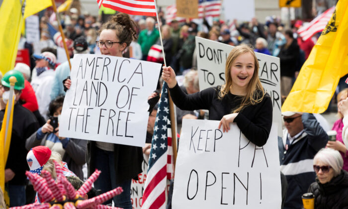 Demonstrators gather to protest against the state's extended stay-at-home order to help slow the spread of the CCP virus in Harrisburg, Pennsylvania, on April 20, 2020. (Rachel Wisniewski/Reuters)