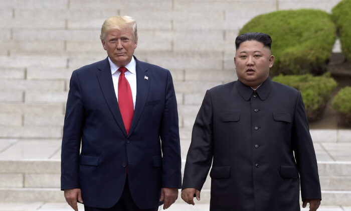 President Donald Trump meets with North Korean leader Kim Jong Un at the North Korean side of the border at the village of Panmunjom in Demilitarized Zone, on June 30, 2019. (Susan Walsh/AP Photo)
